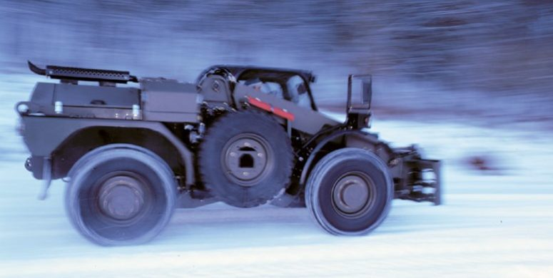 JCB P111 driving in the snow